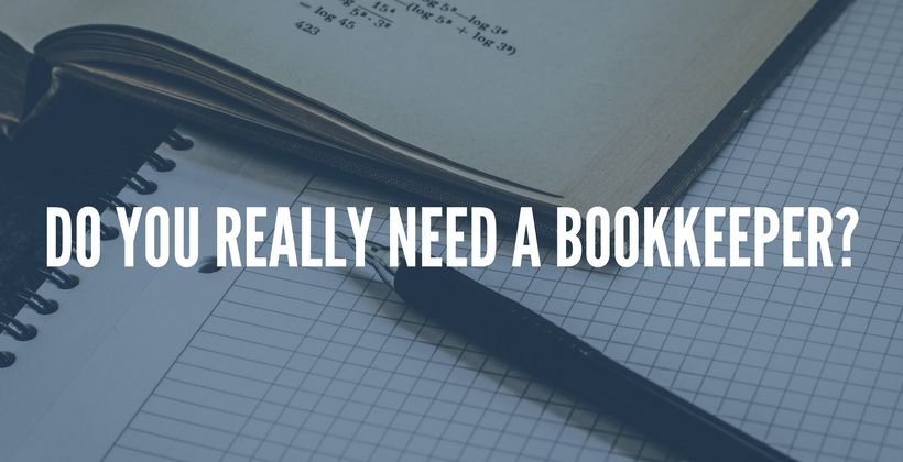 Books and notes lying on a table. Image text: do you need a bookkeeper?